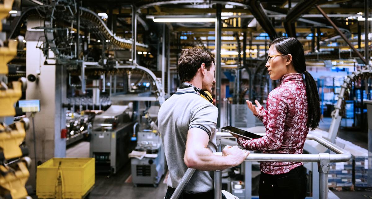 people talking in a factory